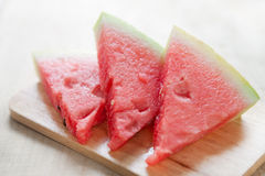 Three slices of watermelon on wooden board Stock Photography