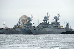 Three small anti-submarine ship of the Baltic Navy on the winter park cloudy January day. Kronstadt Royalty Free Stock Images
