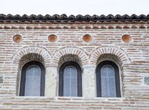 Three small arch windows on a brick wall. Closeup Royalty Free Stock Photo