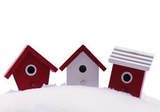 Three small bird houses in snow Royalty Free Stock Images