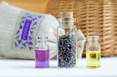 Three small bottles with dry lavender buds, essential oil and natural perfume. Aromatherapy and spa ingredients. Royalty Free Stock Images
