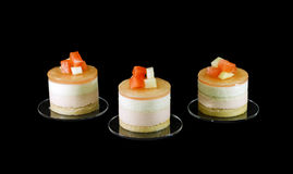 Three small cakes decorated with different fruits Stock Photography