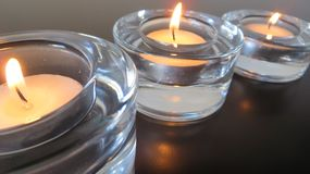 Three small candle peaceful light. In perspective Royalty Free Stock Photography