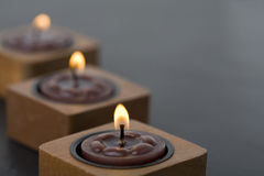 Three small candles in row Royalty Free Stock Images