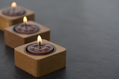 Three small candles in row Stock Images