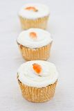 Three small carrot cakes in a line Stock Image