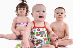 Three small children in swimsuit Stock Photos