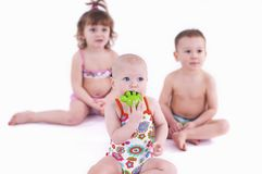 Three small children in swimsuit Royalty Free Stock Photos