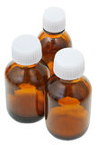 Three small closed brown glass pharmacy bottles Royalty Free Stock Image