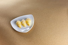 Three Small Croissant on dish Royalty Free Stock Photography