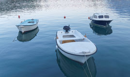 Three small fishing boat in calm water Royalty Free Stock Photo