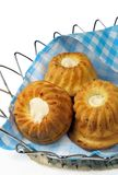 Three small fruitcakes in a basket Royalty Free Stock Image