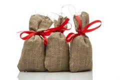 Three small gift sacks Royalty Free Stock Images
