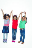 Three small girls standing together Stock Photo