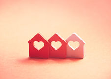 Three small houses with heart Royalty Free Stock Photos