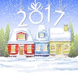 Three small houses in the winter countryside. winter card Happy New Year. winter landscape Stock Photo