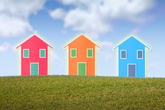 Three small isolated houses on a hill Royalty Free Stock Photography