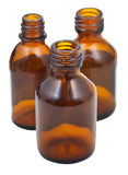 Three small open brown glass oval pharmacy bottles Stock Images