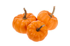 Three small orange pumpkins isolated on white Royalty Free Stock Images
