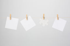 Three Paper Notes and Jigsaw Puzzle Piece Royalty Free Stock Images