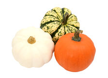 Three small pumpkins - orange, white and green striped gourds Stock Images