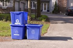 Three small recycle bins on curb. Three small recycle bins by the curb Stock Photography