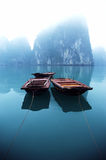 Boats in mist of Halong Bay, Vietnam Stock Image
