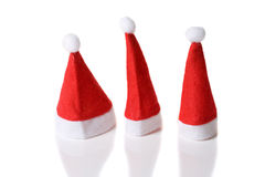 Three small santa hats Stock Photo