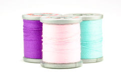 Three small spools of thread, on white Royalty Free Stock Photo