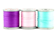 Three small spools of thread, on white Stock Image