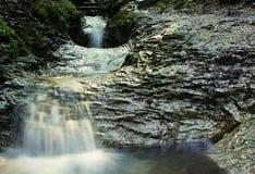 Three small waterfalls. Three small cascading waterfalls on the rock royalty free stock photography