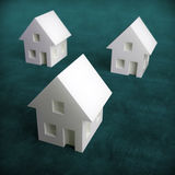 Three small white houses Stock Images