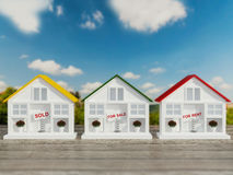 Three small white houses for sale, rent. Stock Images