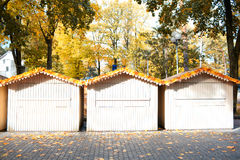 Three small wooden houses Stock Images