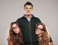 Three smart student friends looking with eyeglasses Royalty Free Stock Photography