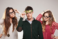 Three smart student friends looking with eyeglasses Royalty Free Stock Photo