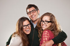 Three smart student friends looking with eyeglasses Stock Photos