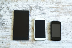 Three smartphone in different sizes Stock Photos