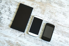 Three smartphone in different sizes Royalty Free Stock Photos