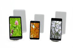 Three smartphones abstract composition. Royalty Free Stock Images