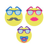 Three smiles. Smiley woman in sunglasses with lipstick, man with moustache and baby with nipple. Stock Image