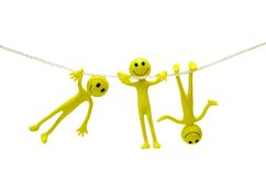 Three smiley actobats. On the rope  isolated on white Stock Photos