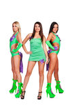 Three smiley go-go dancers. Full length photo of three smiley go-go dancers. isolated on white background Stock Photography