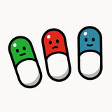 Three smiley pills Stock Images