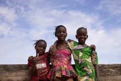 Free Three Smiling Africn Girls Posing Under A Beautiful Blue Sky On A Bridge Royalty Free Stock Image - 172697916