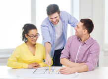 Three smiling architects working in office Royalty Free Stock Photos