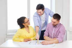 Three smiling architects working in office Stock Image