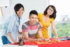 Three smiling Asians Royalty Free Stock Photo