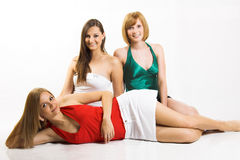 Three smiling beautiful woman. Some beautiful women are smiling against white background Stock Photo
