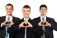 Three Smiling Businessmen Show Love Sign Stock Photo
